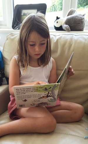 Phoebe reading Wild Things